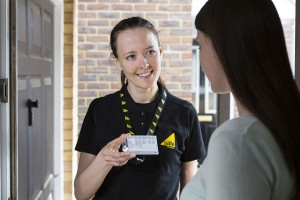 Engineer showing Gas Safe ID card